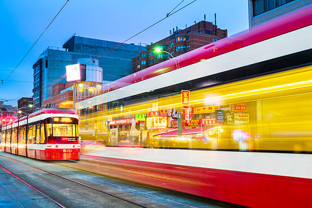 streetcar in chinatown toronto canada - toronto streetcar stock photos and pictures