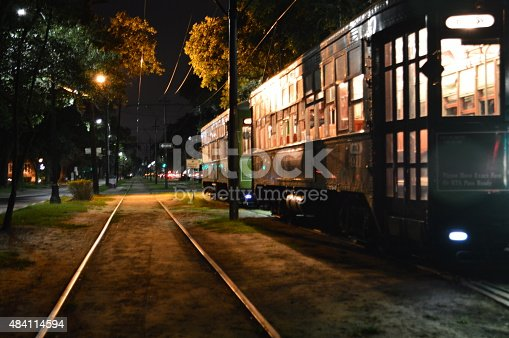Night time view of street cars on St Charles Avenue in New Orleans Louisiana.
