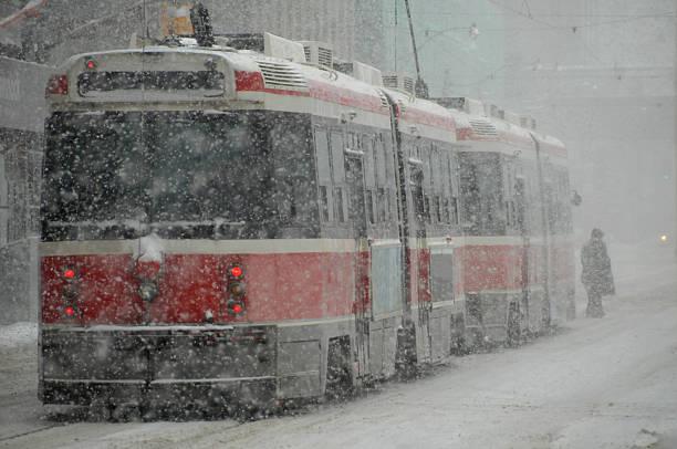 streetcar snowstorm - toronto streetcar stock photos and pictures