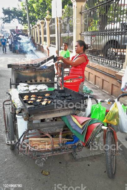 Streetfood saleswoman in legaspi street beside the cathedral compound picture id1024968780?b=1&k=6&m=1024968780&s=612x612&h=mzvoxwlkhp5wa1kj12an4gktgfgbcr56emt v9i1ukm=