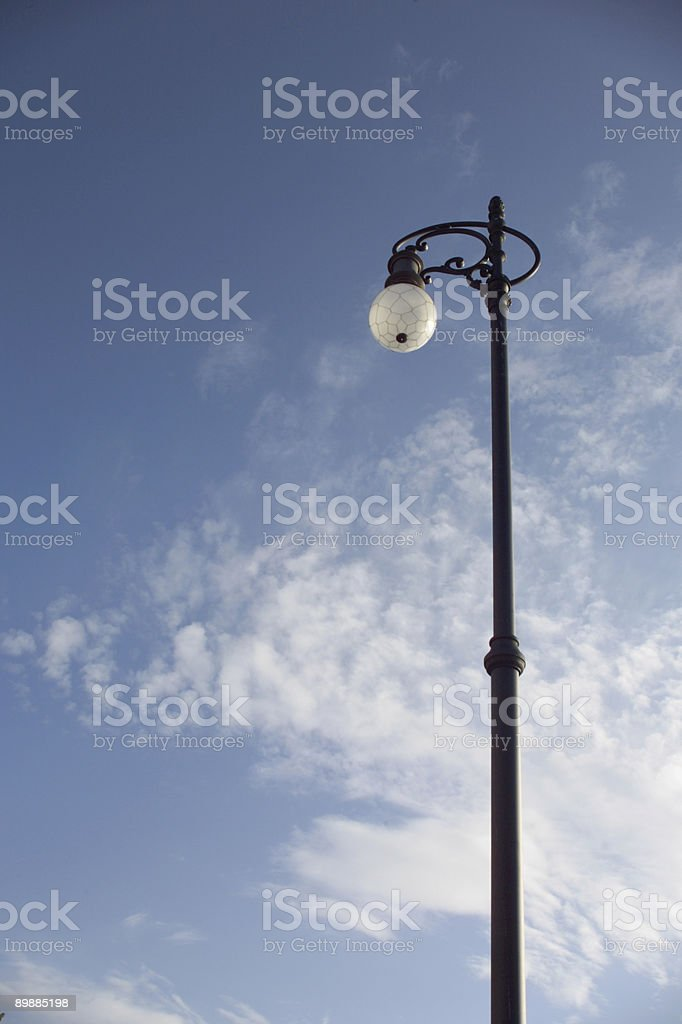 Streetlamp against blue sky background royalty-free stock photo