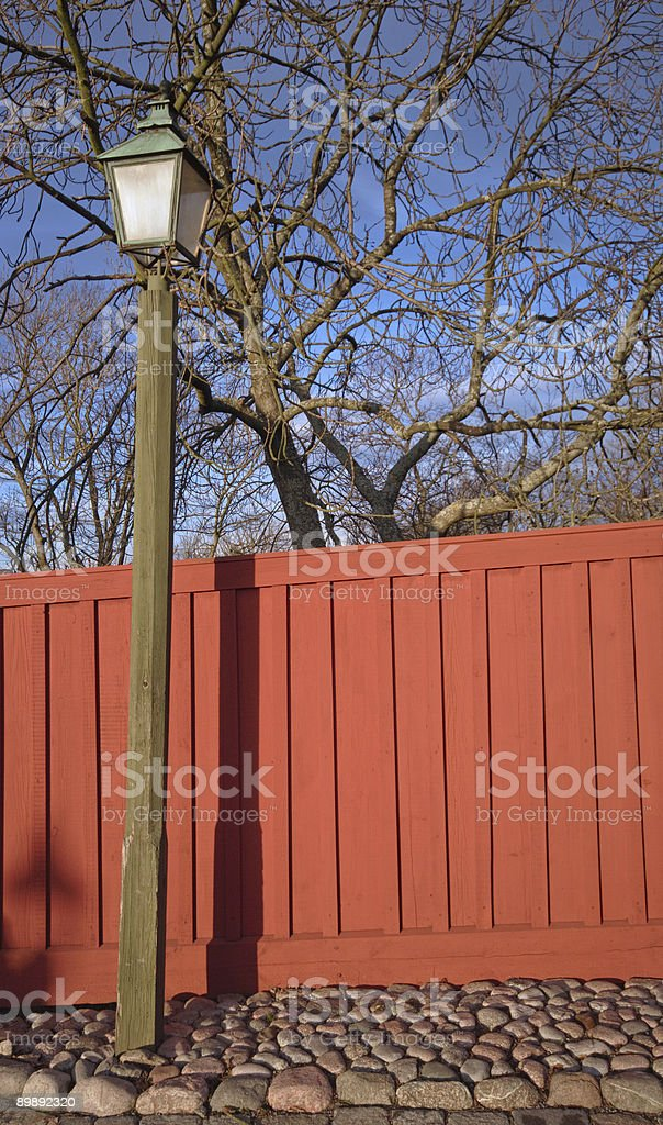 streetlamp and orange wooden fence, Stockholm royalty-free stock photo