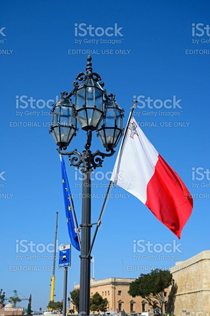 Streetlight and Maltese flag, Valletta. royalty-free stock photo