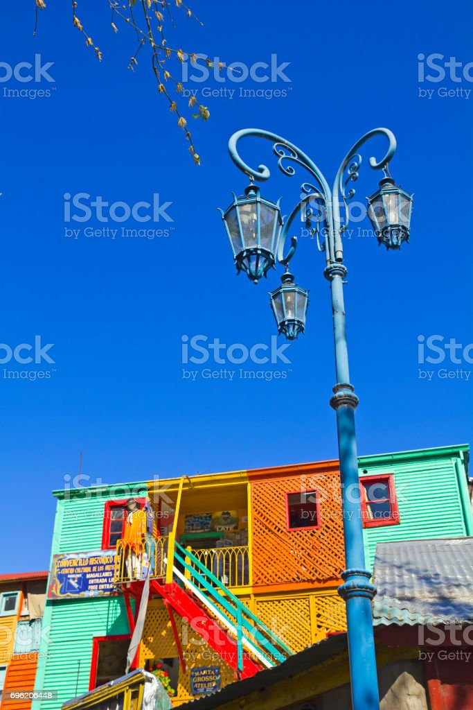 Streetlight with the colorful houses in Caminito in La Boca district, Buenos Aires city, Argentina. stock photo