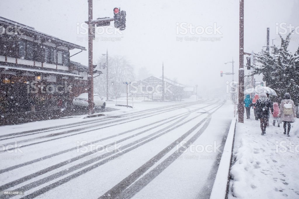Streets covered with frosty snow during heavy snow storm royalty-free stock photo