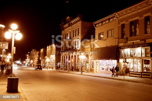 Deadwood, South Dakota, United States - March 9, 2012. People on the Main Street of historic Deadwood, South Dakota. The signs and buildings still reflect the era in which it's rich history was forged.