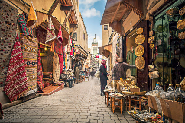 Streets of Fez Stores in the medina streets of Fez, Morocco. arabic style stock pictures, royalty-free photos & images