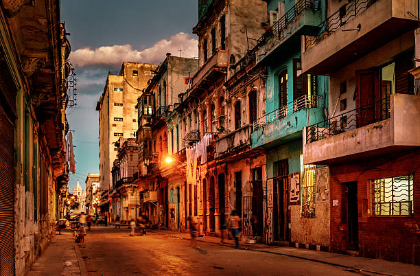 streets of havana, cuba at dusk - cuba stock photos and pictures