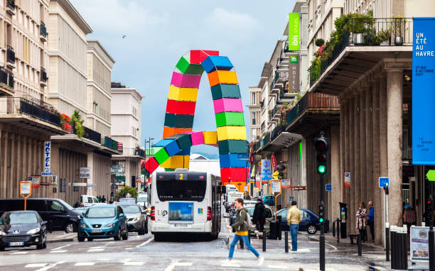 Streets of Le Havre, France Le Havre, France - August 30, 2017: Traffic at the streets of city centre, modern colorful sculpture Catène de Containers by Vincent Ganivet in background. le havre stock pictures, royalty-free photos & images