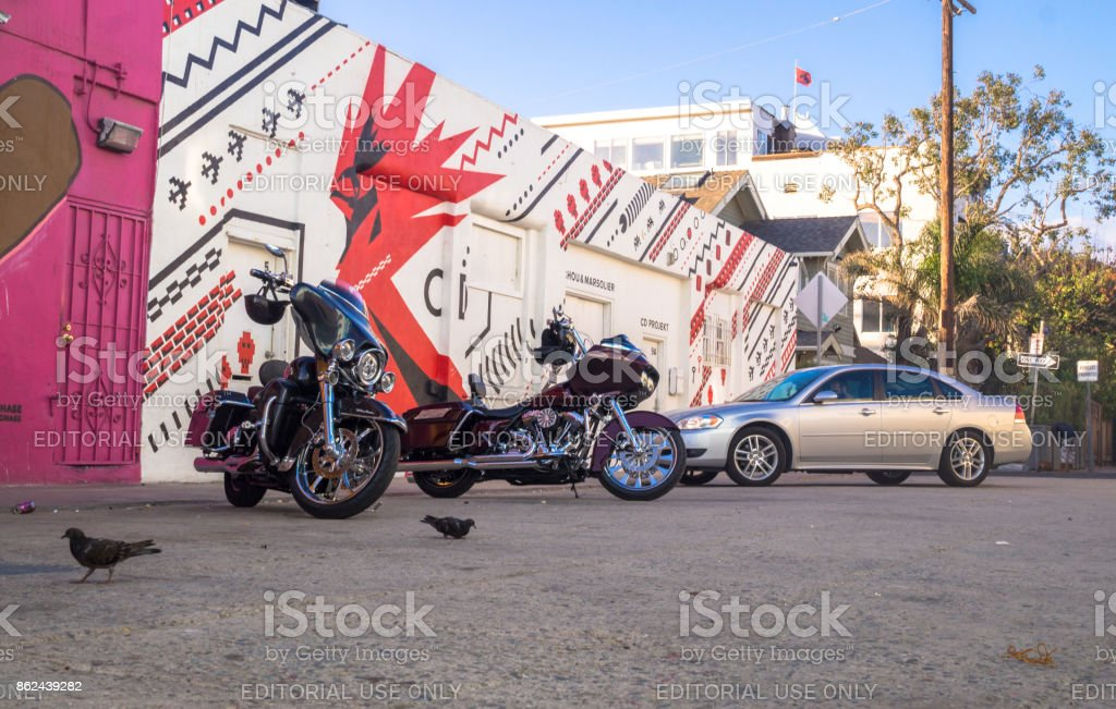 Streets of Los Angeles on Venice Beach. Motorcycles and graffiti on the walls of houses stock photo