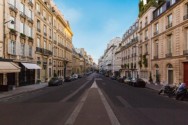 streets of paris - diminishing perspective stock photos and pictures