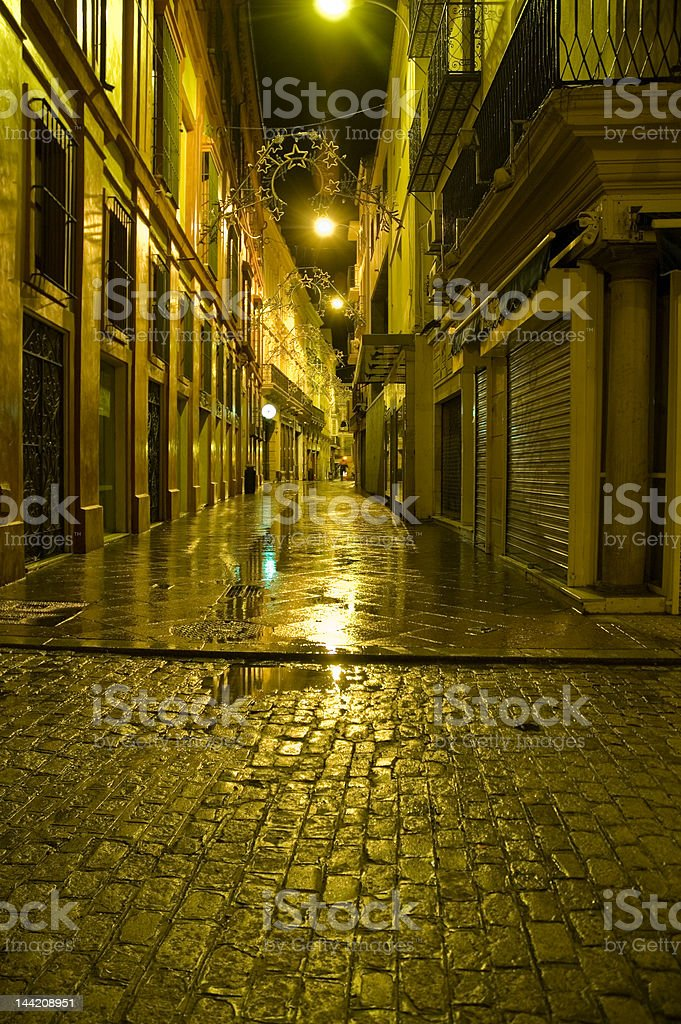 Streets of Sevilla by night royalty-free stock photo