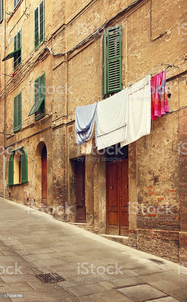 Streets of Siena with drying clothes royalty-free stock photo