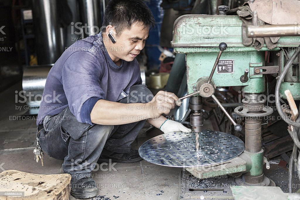 Streetview of machine-shop worker in China stock photo