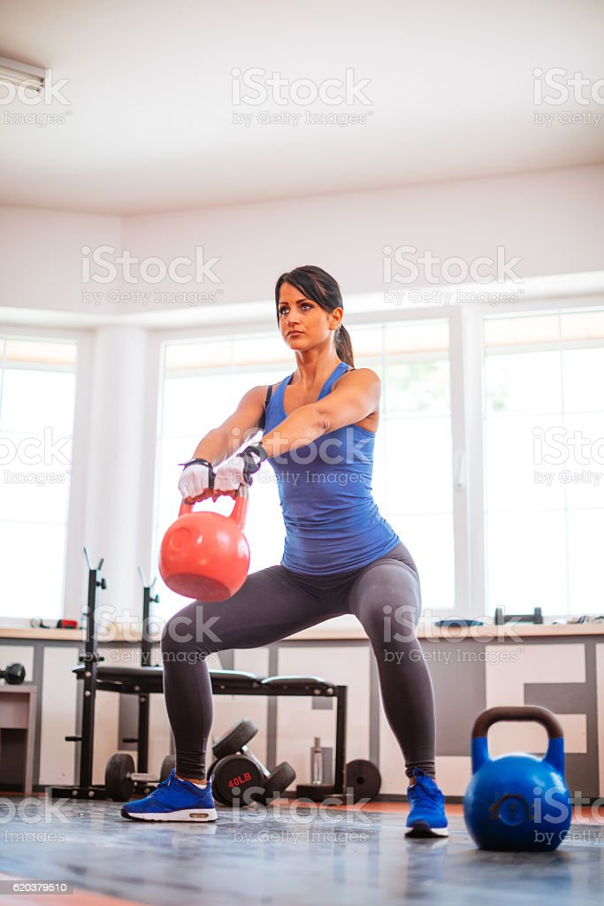 Strenghtening muscles and burning fat in gym zbiór zdjęć royalty-free