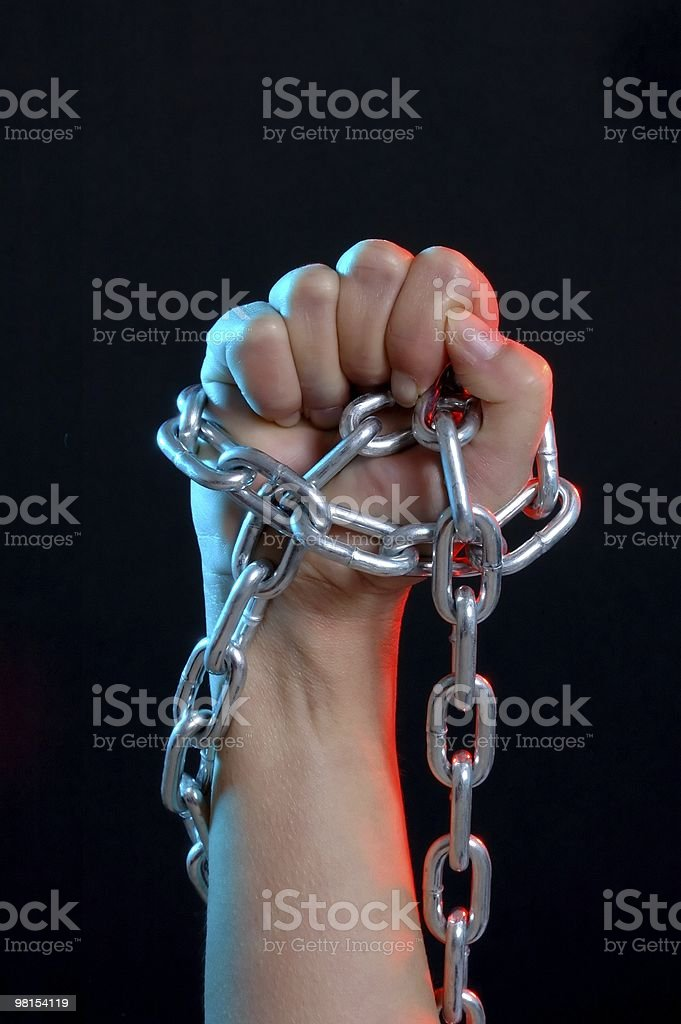 Strength and Power - Fist Holding Chain royalty-free stock photo
