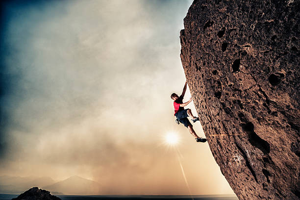 strength - clambering stock photos and pictures