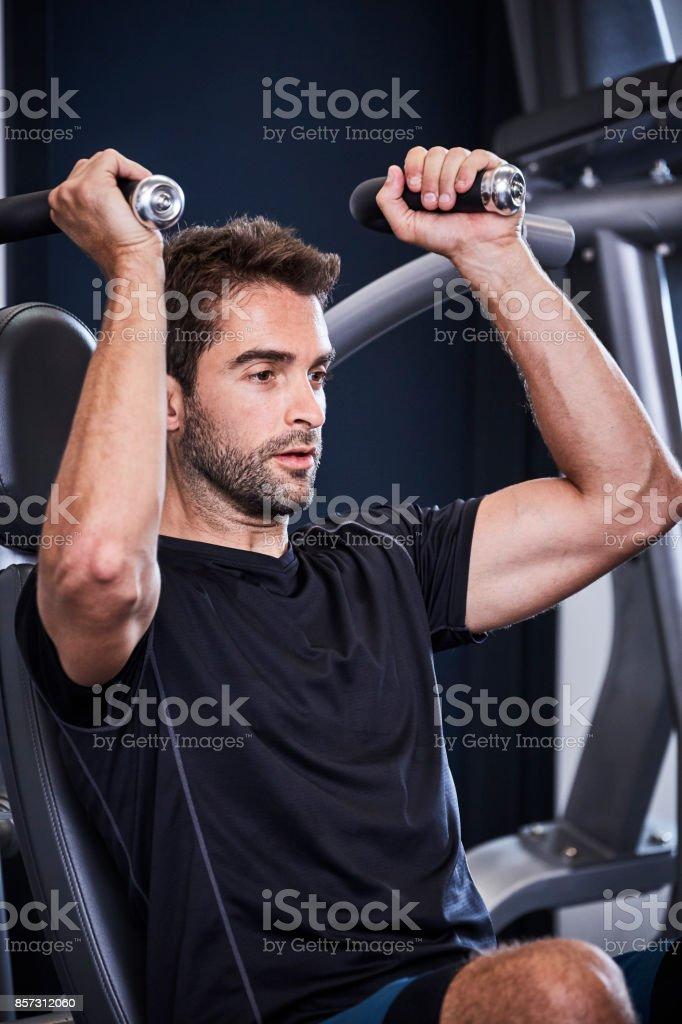 Strength training guy stock photo