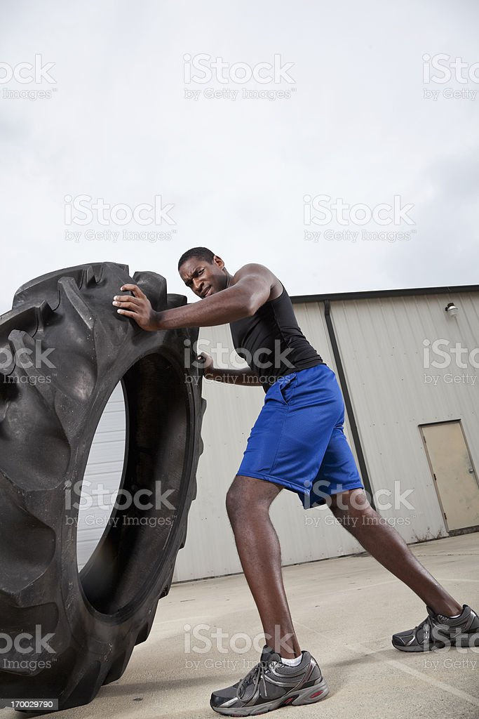Strength training with tractor tire stock photo