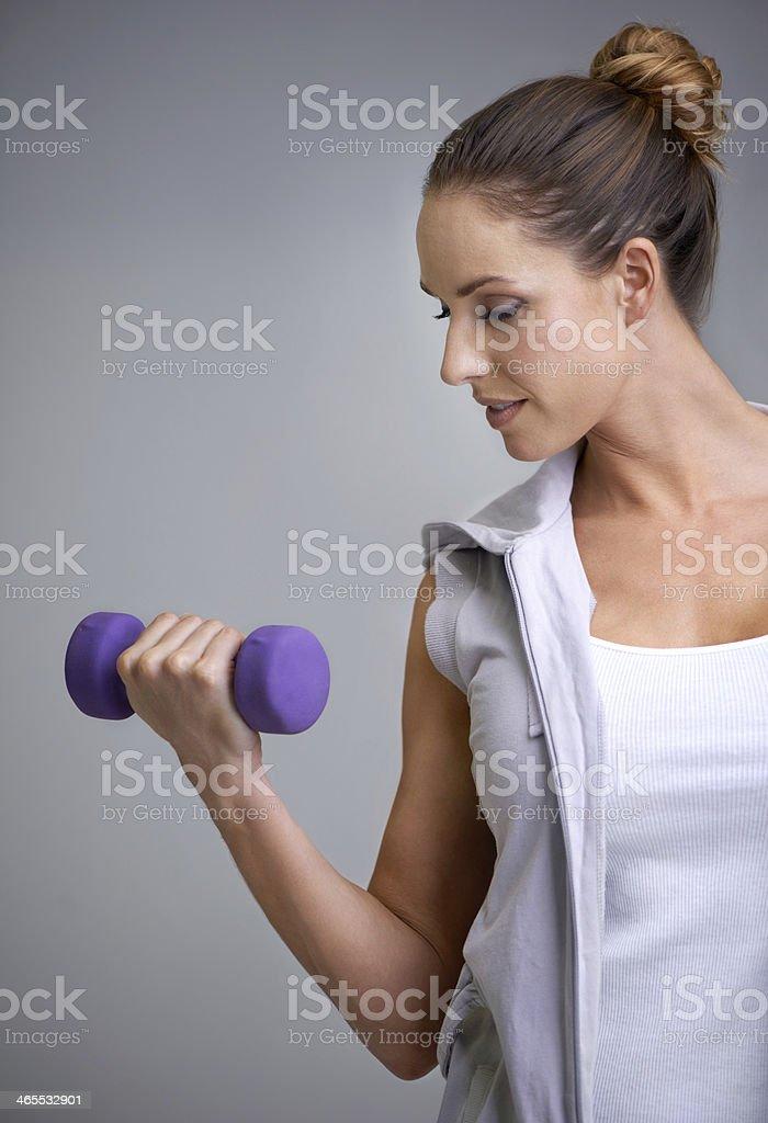 Strengthening her biceps royalty-free stock photo
