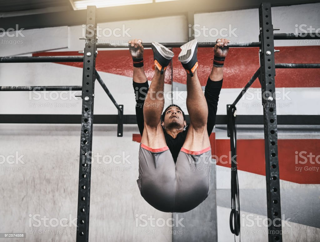 Strengthening His Core With Some Pull Ups Stock Photo & More