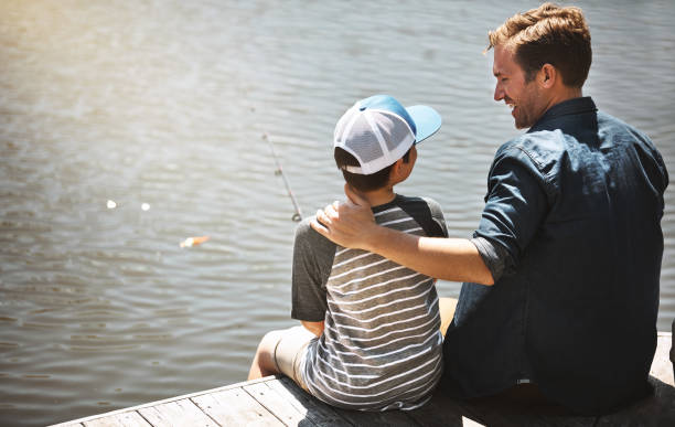 Strengthening their bond over a weekend fishing trip stock photo