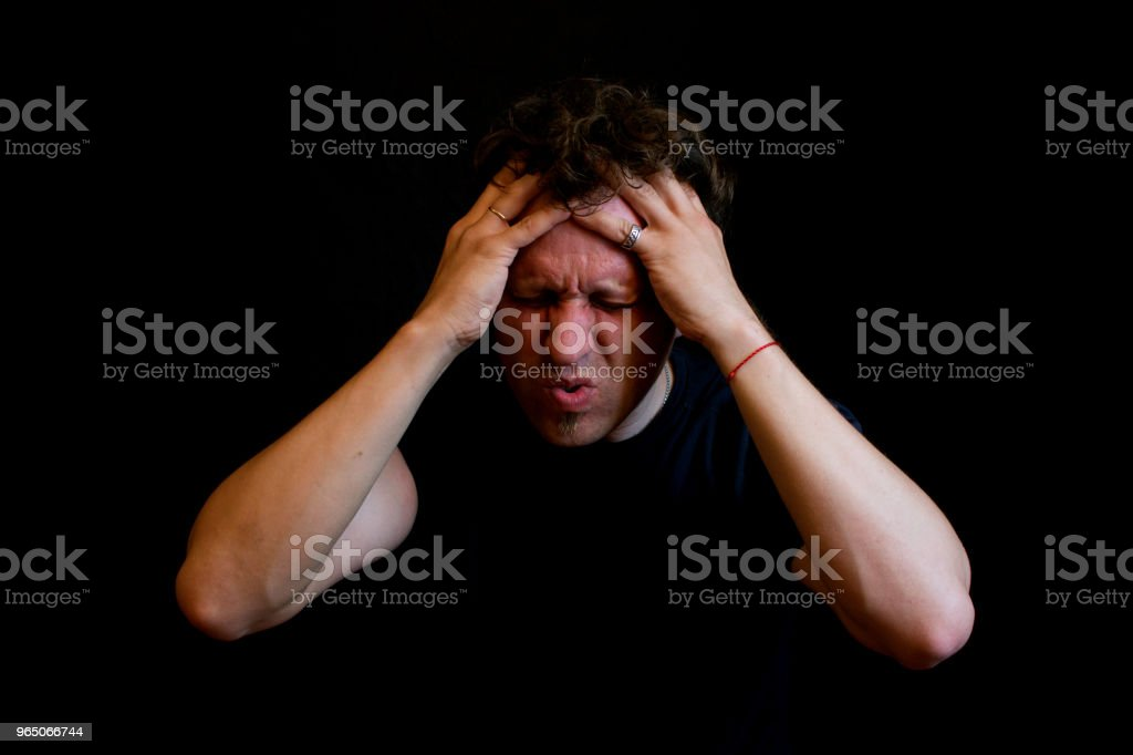 Stress. A man holds his head with his hands. royalty-free stock photo