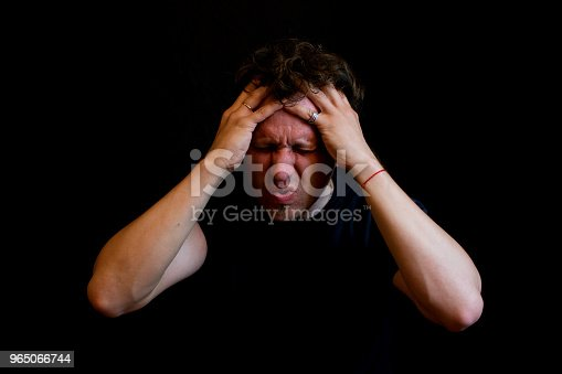 Stress A Man Holds His Head With His Hands Stock Photo & More Pictures of Adult