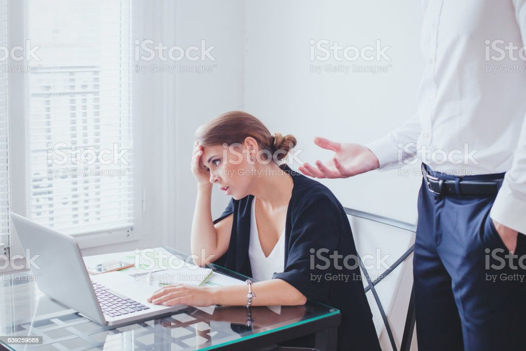 stress at work, emotional pressure, angry boss and  unhappy employee stock photo