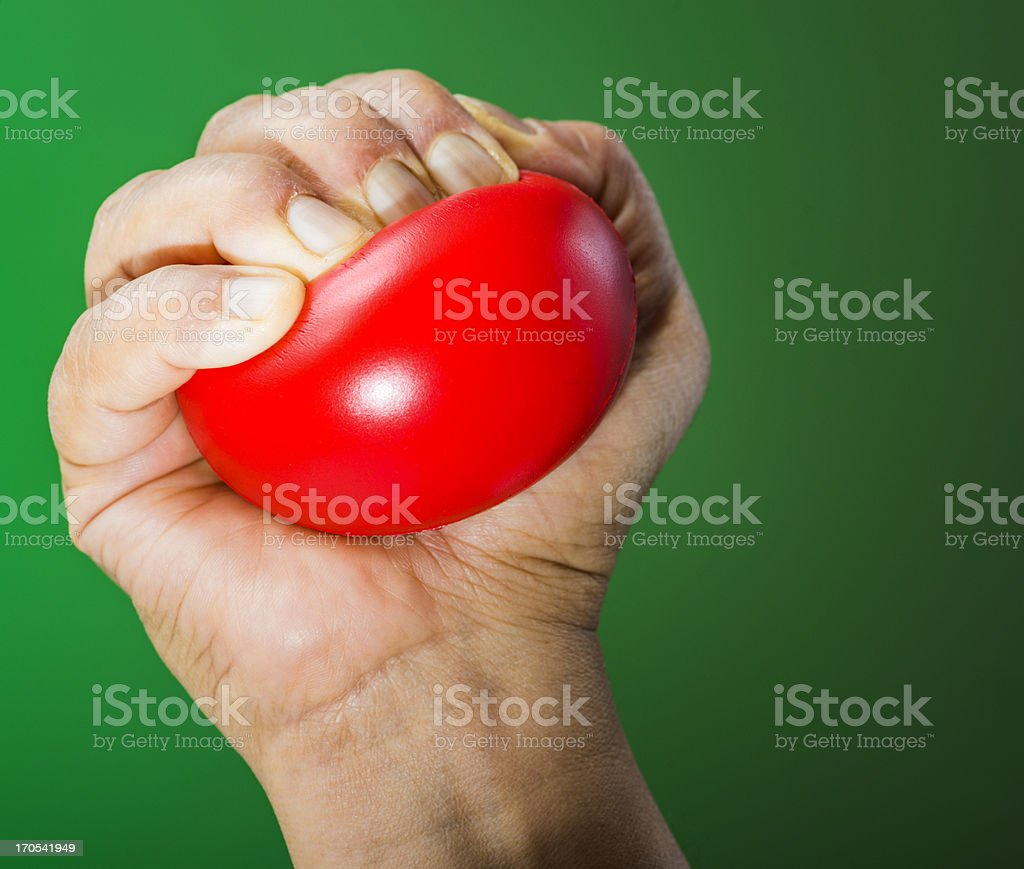 Stress ball in hand royalty-free stock photo