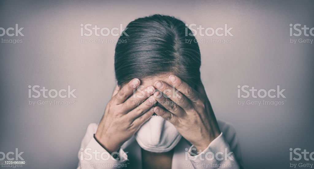 COVID-19 Stress business woman crying covering face mask with hands Coronavirus employment recession anxiety COVID-19 Stress business woman crying covering face mask with hands Coronavirus employment recession anxiety. Adult Stock Photo