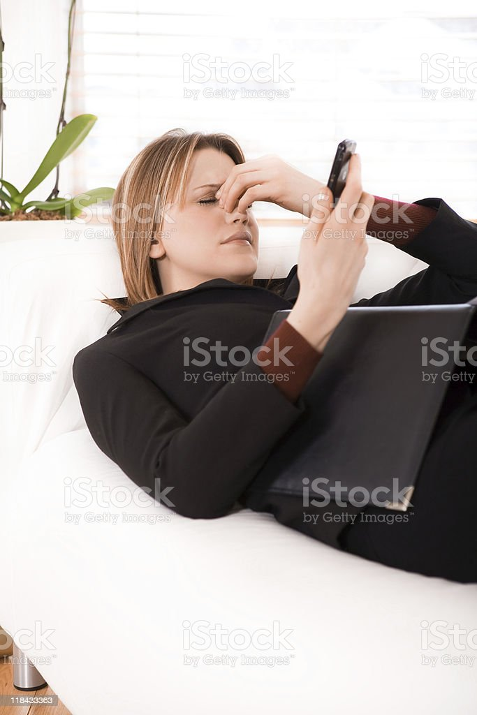 Stress Businesswoman holding her cellphone royalty-free stock photo