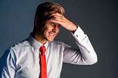 istock stress caucasian businessman officer feel bad with work hard and office syndrome hand touch painful body part 1159054726