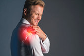 istock stress caucasian businessman officer feel bad with work hard and office syndrome hand touch painful body part 1159054736
