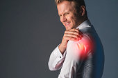 istock stress caucasian businessman officer feel bad with work hard and office syndrome hand touch painful body part 1159054804