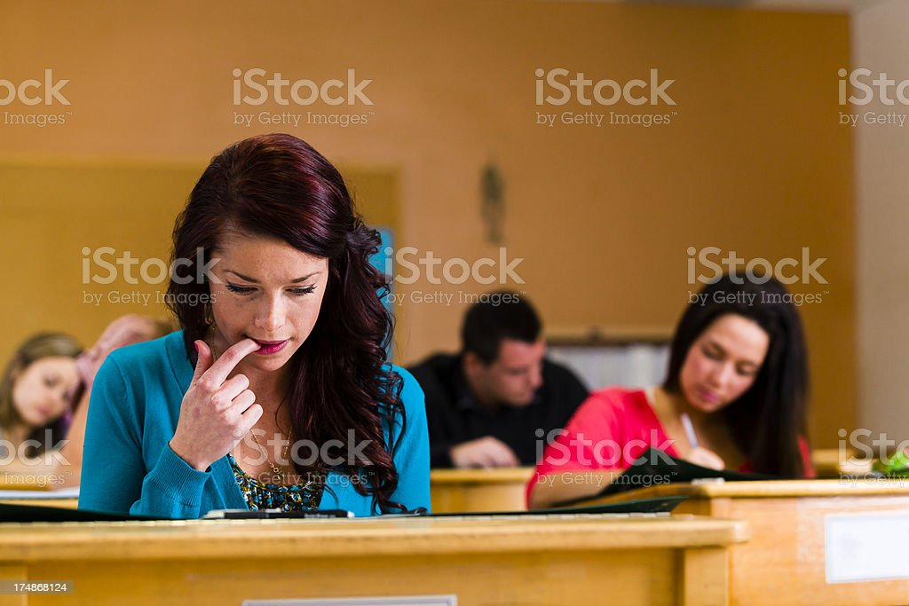 This teenager is stressed out with an exam
