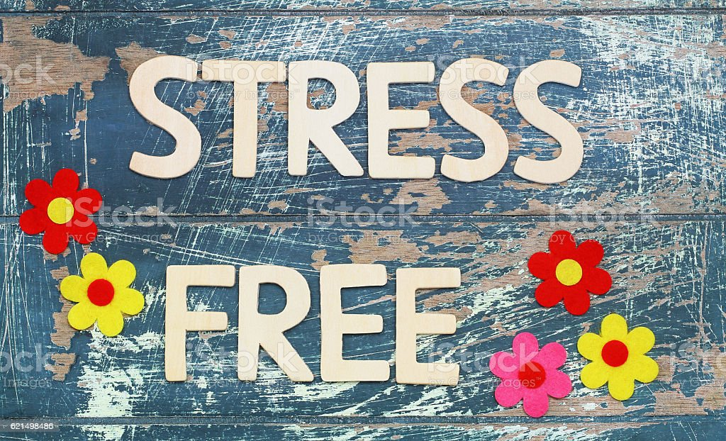 Stress free written with wooden letters on rustic wood, flowers photo libre de droits