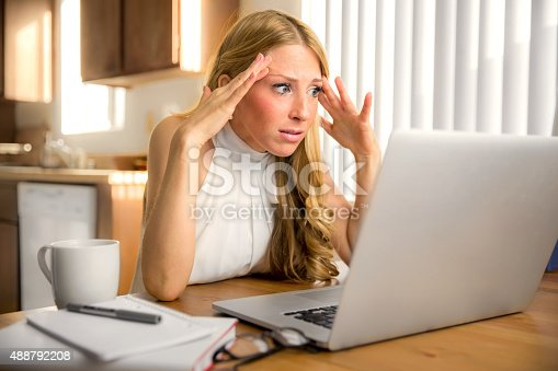 istock Stress frustrated panic news email reading laptop computer depressed 488792208