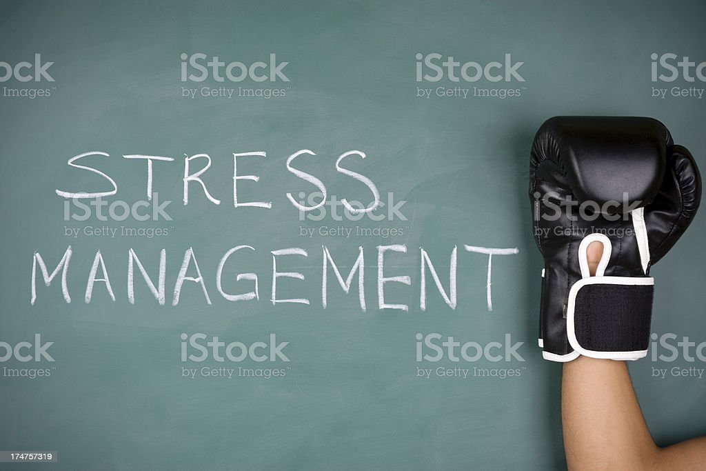 Stress management and boxing glove on blackboard royalty-free stock photo