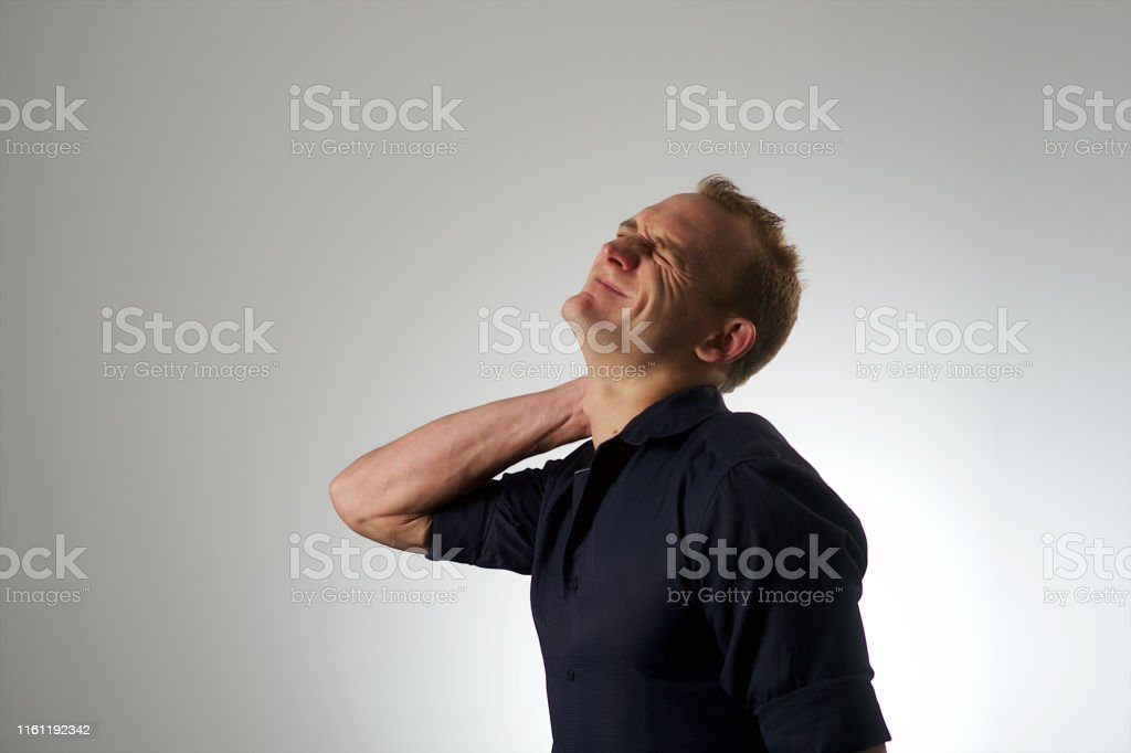 Studio Portrait of a young Caucasian male against a white background...