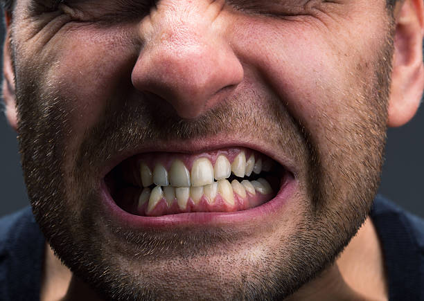Stress Closeup of mouth of very stressed man grinding stock pictures, royalty-free photos & images