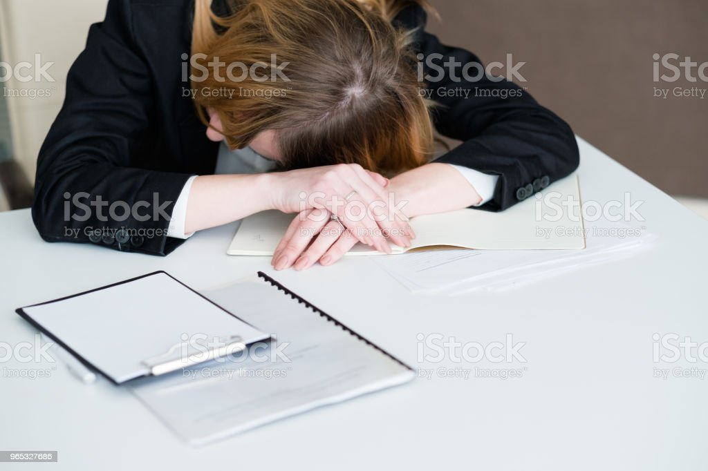 stress tiredness overworking exhausted woman desk royalty-free stock photo
