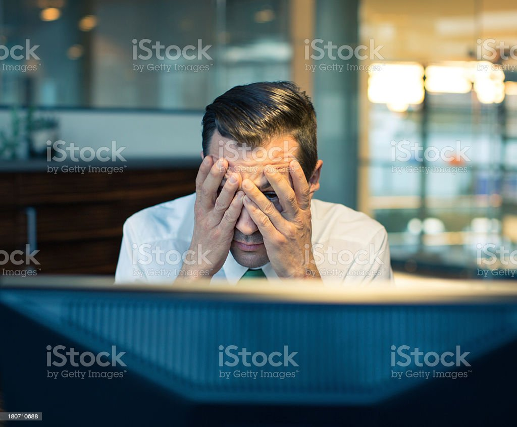 Stress while working late at night stock photo