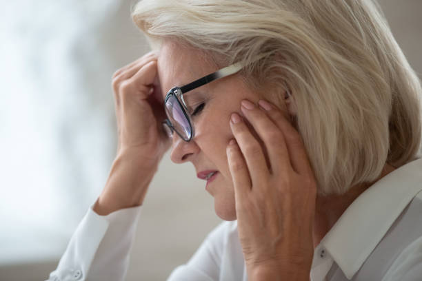 Stressed aged woman in glasses suffering from headache Close up of stressed senior businesswoman in glasses touch head suffering from strong headache or migraine, aged grey-haired woman worker wearing spectacles feel unhealthy having health problems headache stock pictures, royalty-free photos & images
