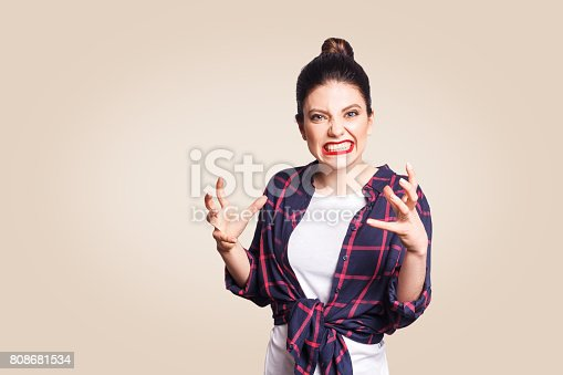 istock stressed and annoyed young casual styled caucasian woman 808681534
