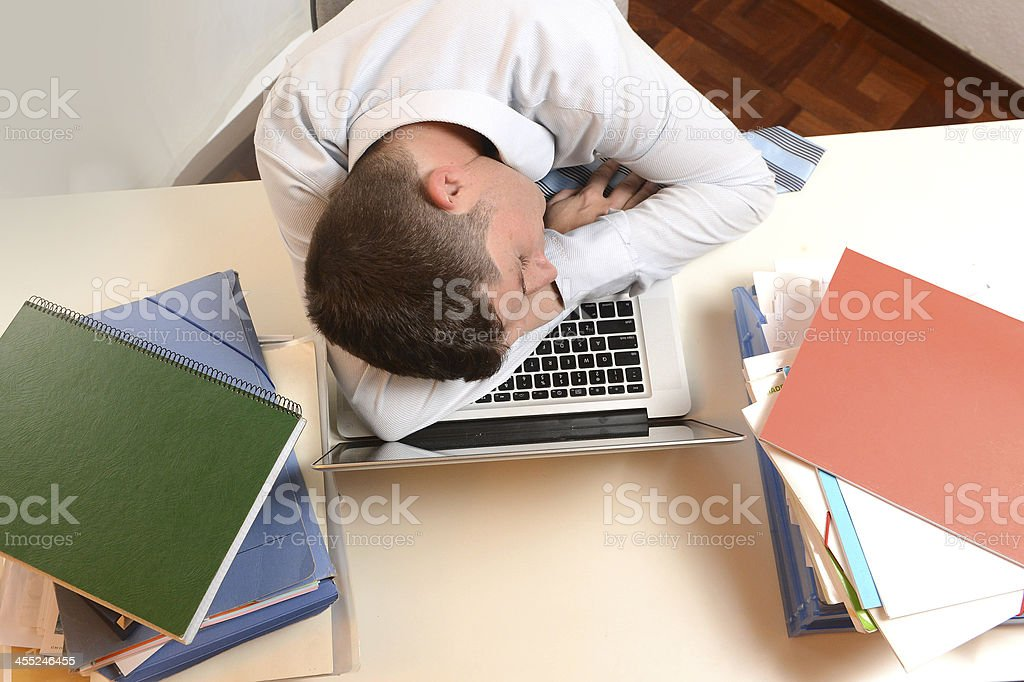 Stressed and Overworked Businessman sleeping stock photo