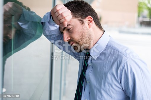 1181817161 istock photo Stressed and tired manager face expression portrait 947976218