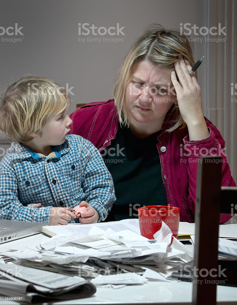 Stressed and tired mother dealing with financial issues royalty-free stock photo