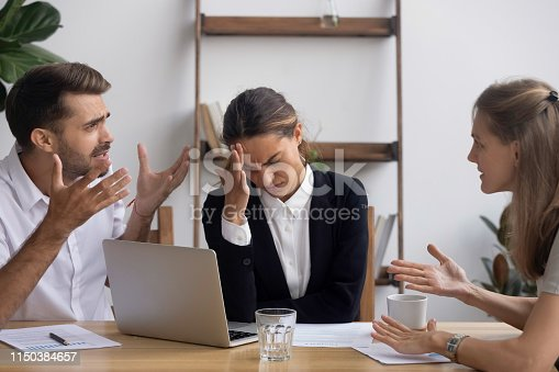 istock Stressed annoyed office employee having headache migraine at business meeting 1150384657