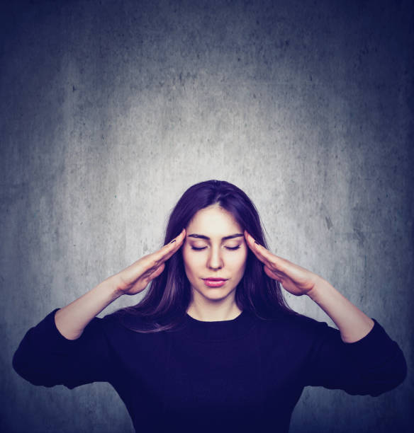 Stressed anxious woman with headache stock photo